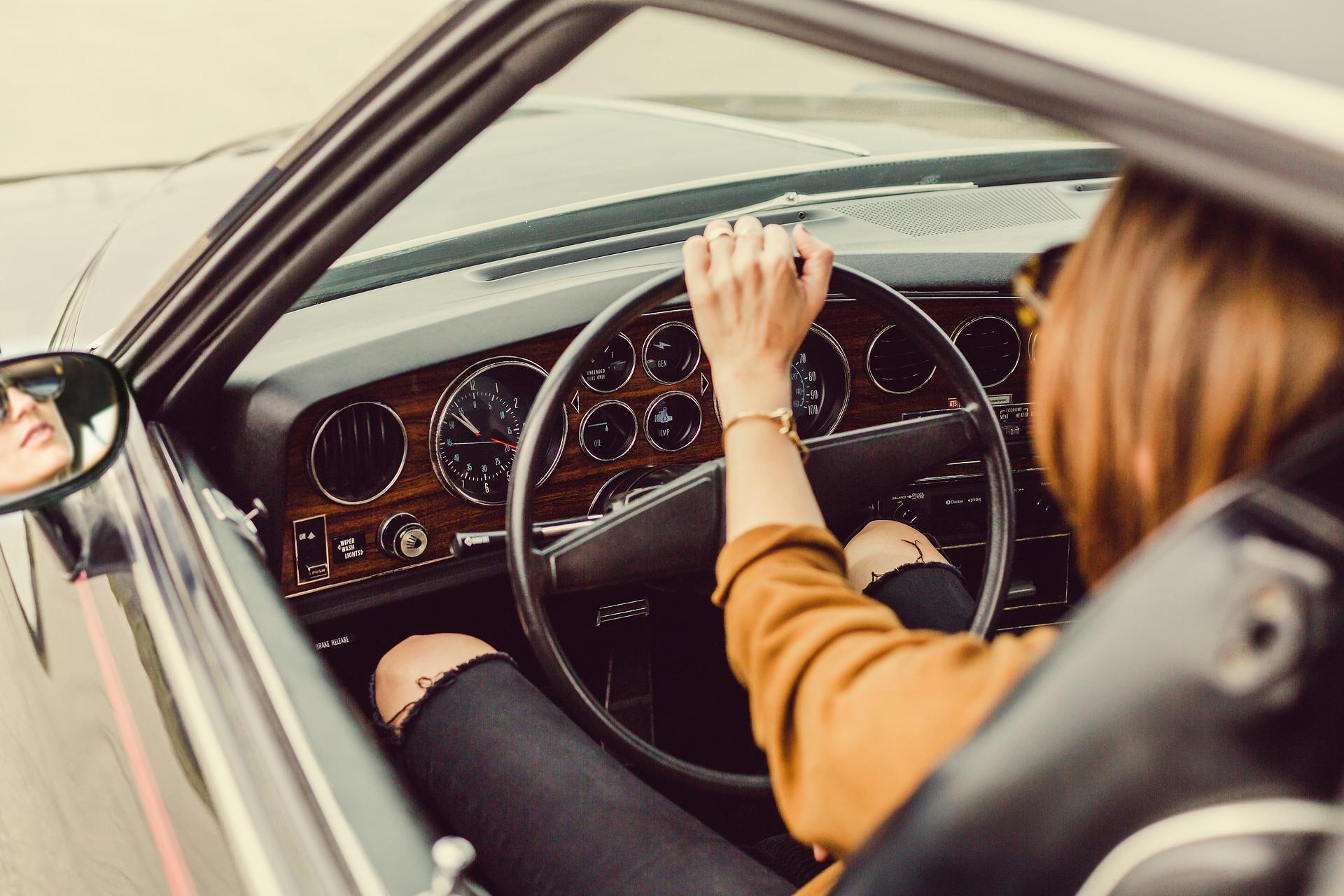 girl driving in car